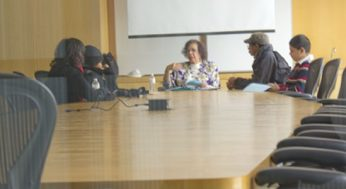 A group of students learning criticial interview skills.