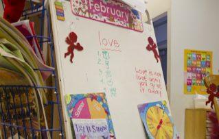 The daily lesson board inside Esau's kindergarten class.