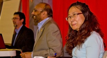 Ed Castro (far left) and Eden Gajraj (center) ran the Town Hall Meeting, which was sponsored by the Friends of the Scarborough Hospital. Roberta Wong (right) was a translator.