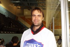 Retired hockey player, Curtis Joseph smiles for the camera after giving a speech during the rink opening ceremony.