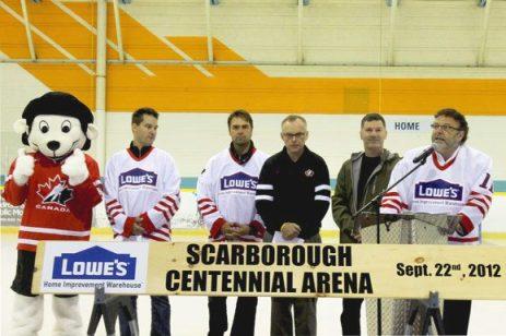 Lowe's representives, Curtis Joseph and Councilor Glenn De Baeremaeker, present the newly renovated rink at the East Centennial Recreation Centre.