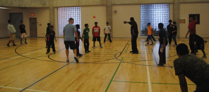 The scrimmage gave the members of the YMCA after school program a change to face-off against a professional athlete.