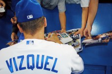 Omar Vizquel signing autographs for fans in his final game of his baseball career.