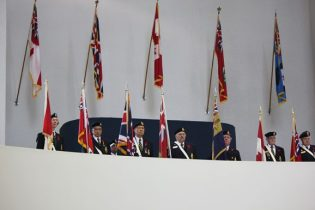 Veterans stand at attention at Scarborough Civic Centre.