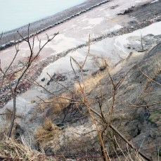 The cliff slope is being graded to allow vegetation to grow.