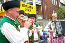 Folk musicians happily played their instruments to crowds.