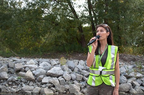 Tour guide and TRCA senior aquatic expert Christine Tu speaks at the annual Salmon Run on the banks of Highland Creek in Scarborough on Sept. 29. The event coincides with the creek's Chinook salmon spawning run.