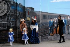 Artist De Anne Lamirande and her team help bring the Warden Underpass Mural to life.