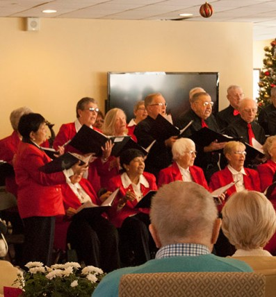 Choir members are focused on delivering a large variety of Christmas carols.