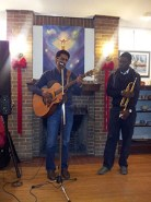 Musicians perform at the art exhibition in Scarborough.