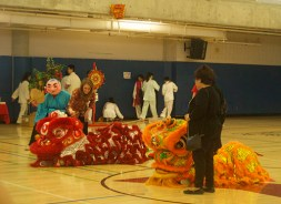 The red and orange dragons continue their vibrant performance.