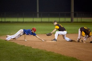 Josh Grassick, left, slid past the base but was safe after attempting to advance to third on a ground ball.