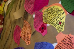 Leaves on the memorial tree. Some students wrote their reflections on the act of remembrance in French.