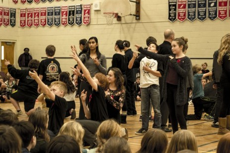 Grade 8 students act out the lyrics to the famous World War I poem, In Flanders Fields, by Canadian soldier John McCrae.