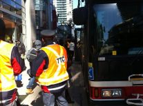 TTC riders board shuttle buses after long wait.