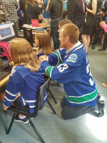 Henrik Sedin of the Vancouver Canucks talks with students at Glen Ames Senior Public School.
