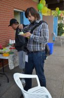 Man eating cake at the grand re-opening of the Thorncliffe Park Tennis Club.