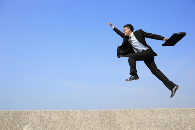 business man jump and run with blue sky background, full length, asian male