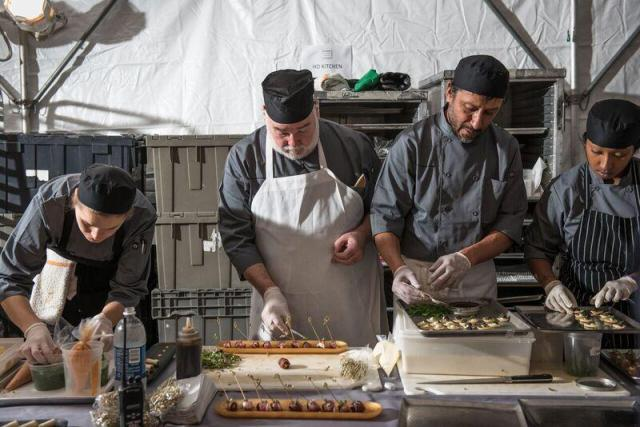 The Starr Catering team prepares their next course. Photo by Jennifer May