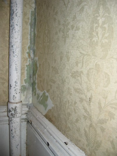 How to repair a crumbling corner of two plaster walls behind an old cast iron steam pipe ...