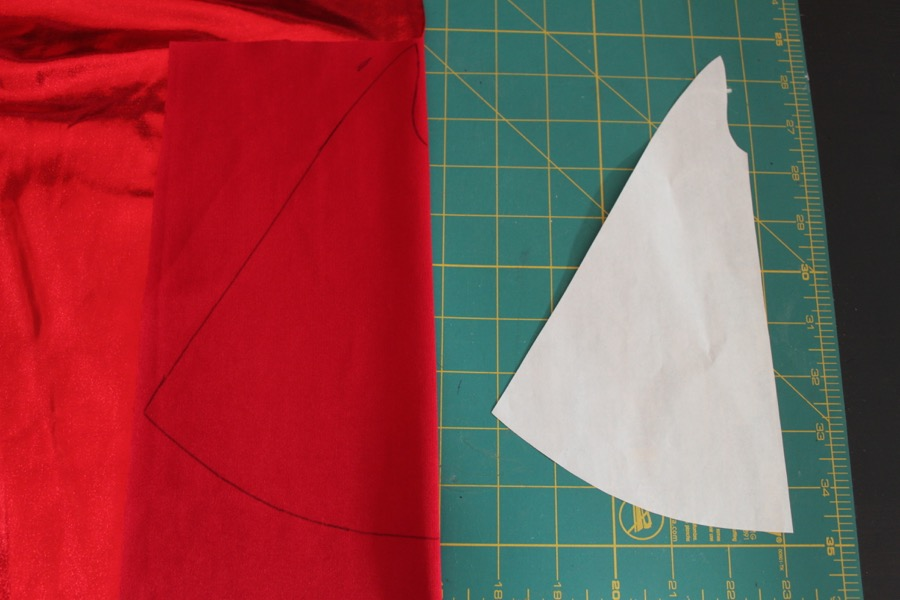 Fold red fabric in half and trace cape.