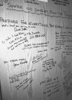 Signatures and words of inspiration cover the cabinets inside the RV.