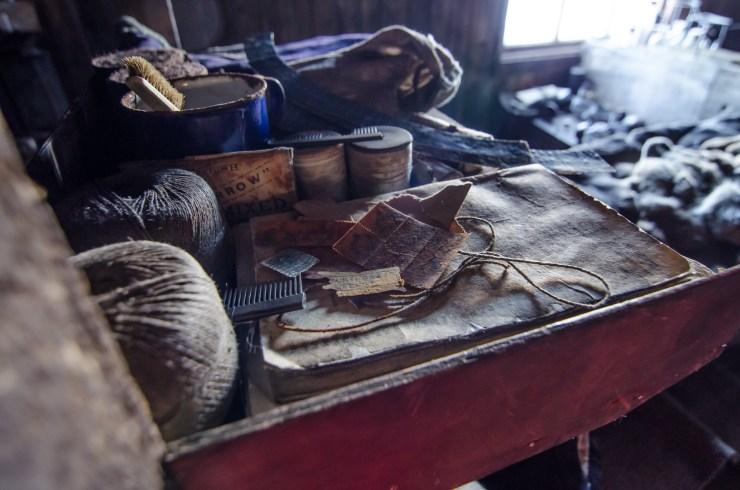 Bedside belongings by one of the bunks inside Cape Evans Hut