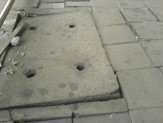 "The ""Descent Into Hades"" Loose Manhole Cover"