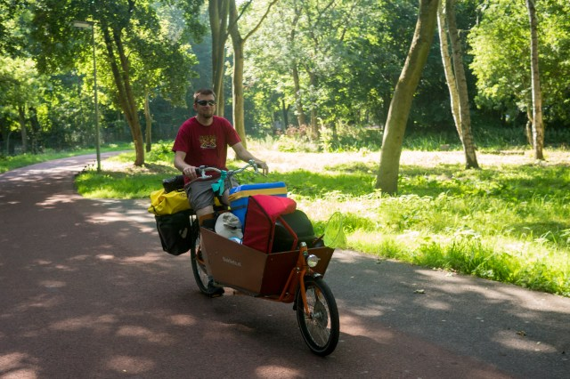 Andrew with Max and the rest of the gear, loaded into our Dutch cargo bike.