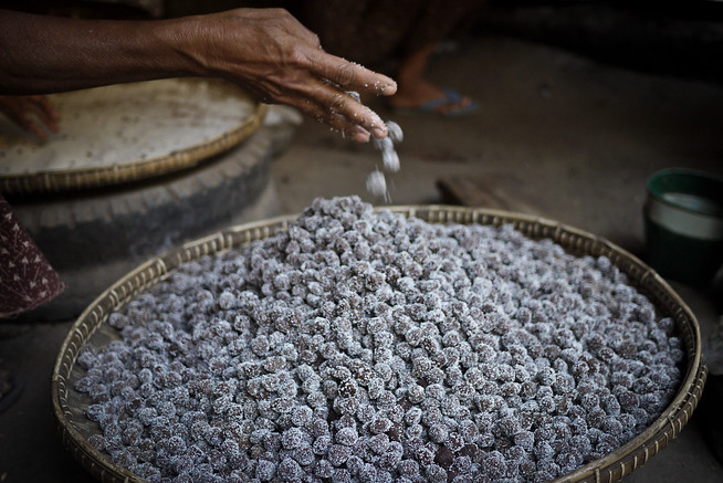 Hand-rolled sour plum candies made in the Bagan region of Burma.