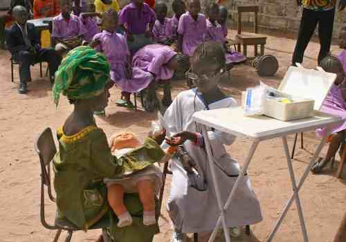 Children learning about malaria in The Gambia