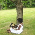 Travel-Xena-Reading-Under-Tree