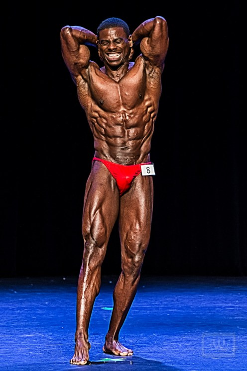 Bodybuilding Champion Flexing Abs