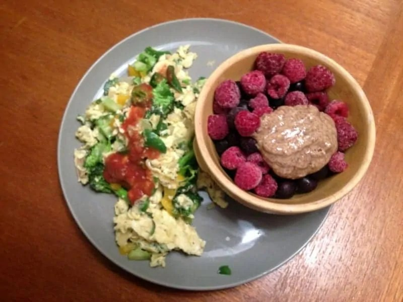 whole 30 scramble with berries and ab