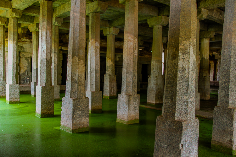 Water covers the inner sanctum of the Underground Shiva temple in Hampi