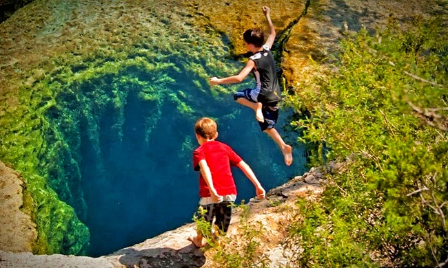 Kids jumping in jacobs well