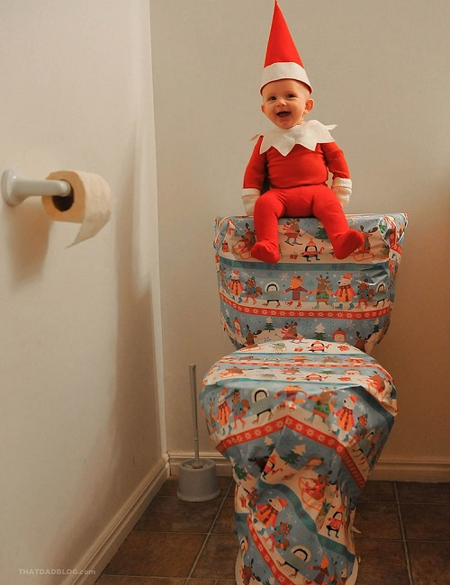 kid sitting in toilet