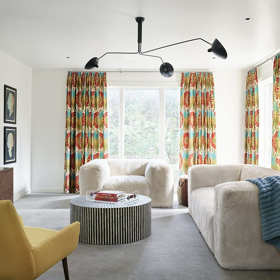 The  children's  common  room,  located  downstairs  between  the  two  girls'  bedrooms,  plays  to  both  of   their  personalities,  with  cozy  furnitur e and bright colors.