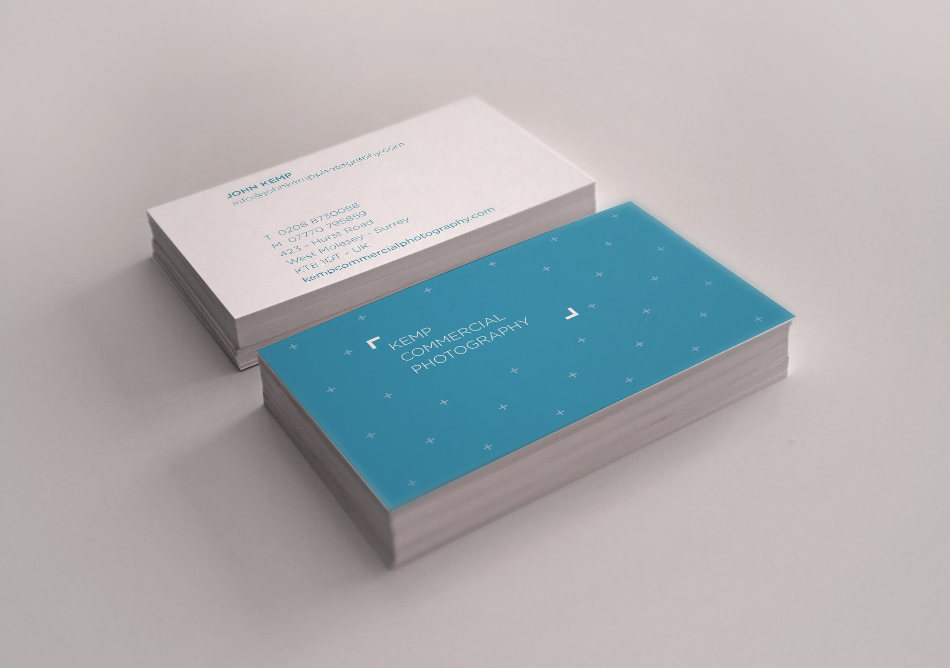 A photo of the business card design for Kemp Commercial Photography | Tribus Creative - brand identity design for small business