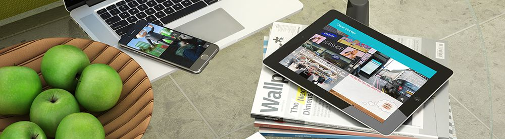 An image of a smartphone and tablet displaying the homepage of the Grand Visual website – What Makes a Great Website?