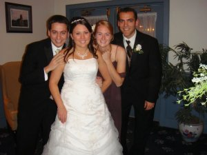 My husband and I with the Bride and Groom