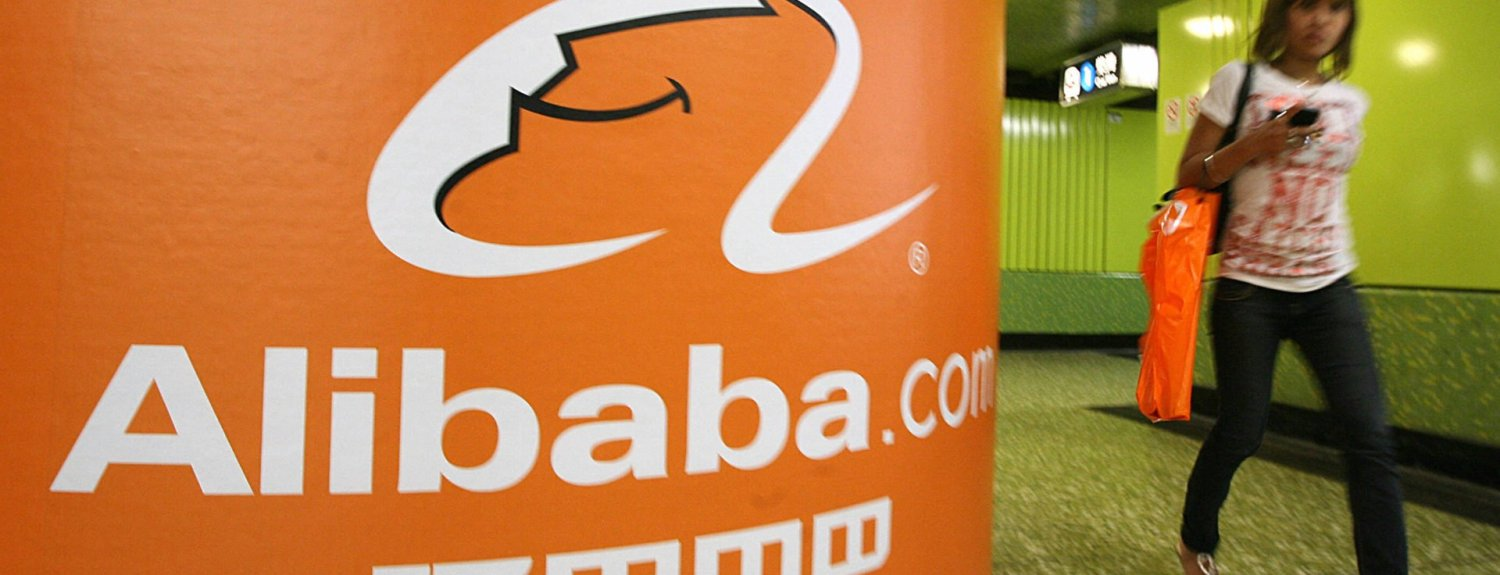 A pedestrian walks past Alibaba.com advertising in Hong Kong, 29 October 2007. Chinese business to business website Alibaba.com says it aims to raise 11.6 billion Hong Kong dollars (1.5 billion USD) in what it called the largest Internet IPO since Google.    AFP PHOTO/MIKE CLARKE (Photo credit should read MIKE CLARKE/AFP/Getty Images)