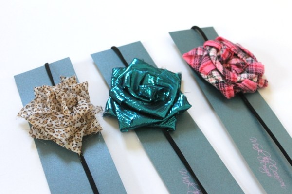 Black headbands with large fabric flowers