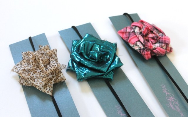 Black headbands with large flowers - 1 leopard print, 1 shiny turquoise, and 1 pink flannel flower available
