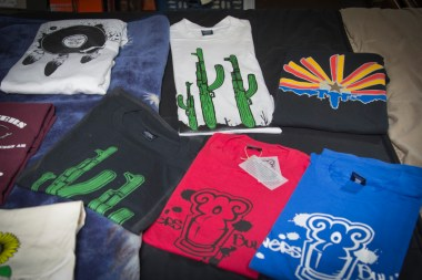 Shirts designed by graffiti artists with Flowers and Bullets are a source of income for the group.