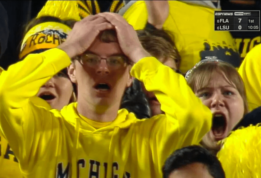 sad michigan fans reacting to devastating last second loss