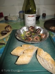 Some nice wine and escargot sautéed in butter and white wine with a fresh Baggett.
