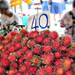Rambutan at a street market in Bangkok.  40 baht per kilo or about 60 cents a pound.