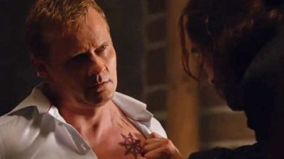 One of the Hessians (Carsten Norgaard) shows off his chest tattoo on Sleepy Hollow.