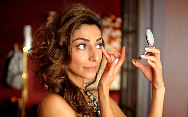 Delia checks her makeup on Girlfriends' Guide to Divorce